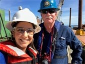 Public Information Officer Yaremi Farinas and Director of Planning and Dvelopment Carl Baker pictured on dredge