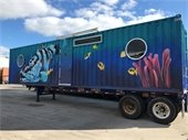Shipping container home with fish painted on it