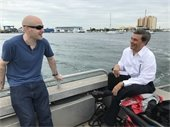 Port Executive Director Manuel Almira heading to Peanut Island with FOX 13 Tampa reporter.