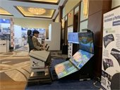 Port Commissioner Dr. Jean Enright trying out a maritime simulator.