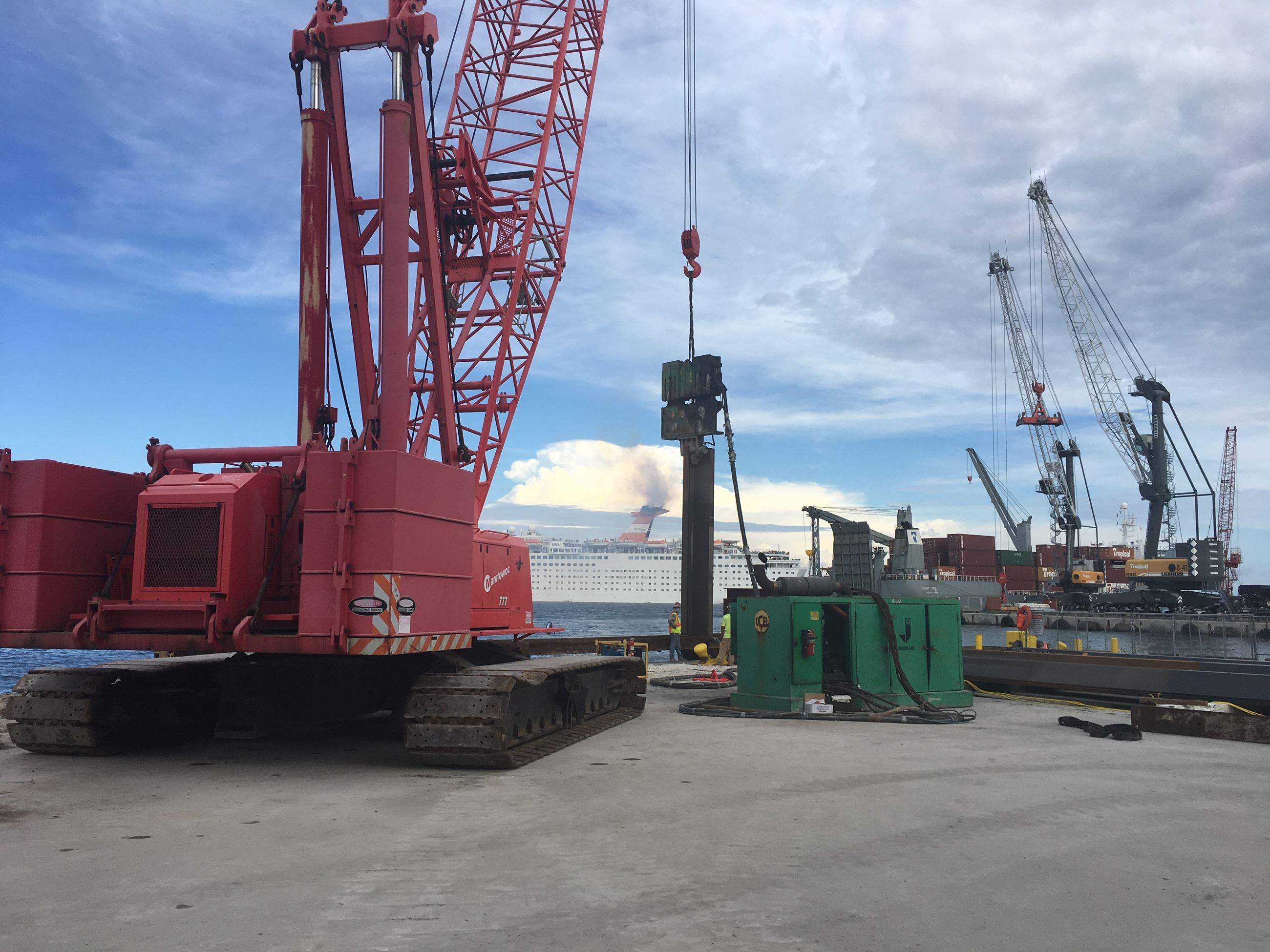Heavy duty equipment used to install sheet pile