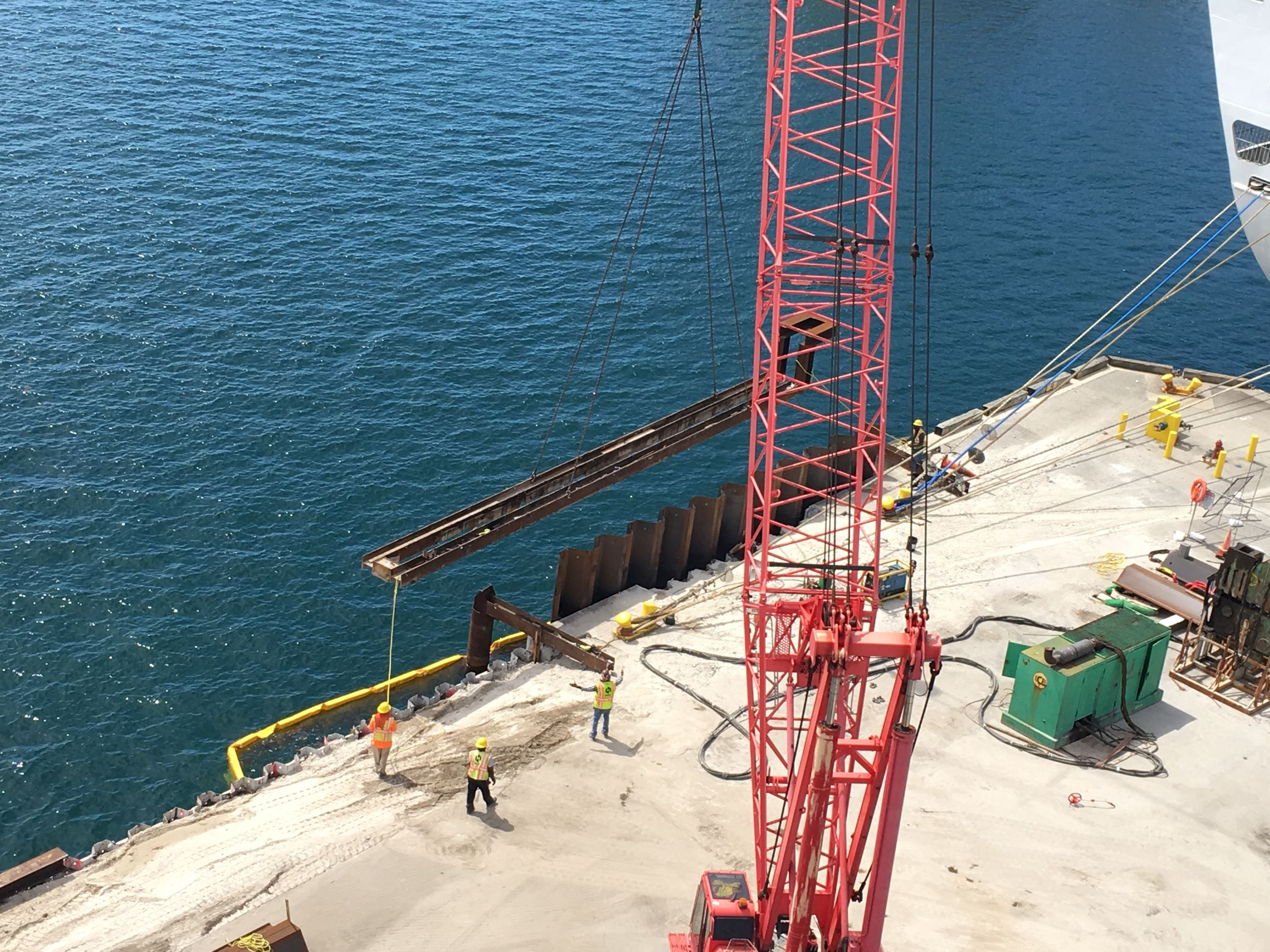 New steel sheet pile installed in front of existing sheet pile